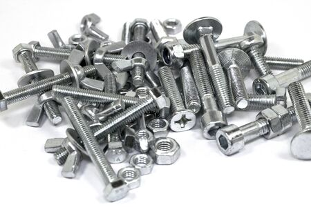 bolts and nuts: Fixing bolts, screws, washers and nuts on white background.