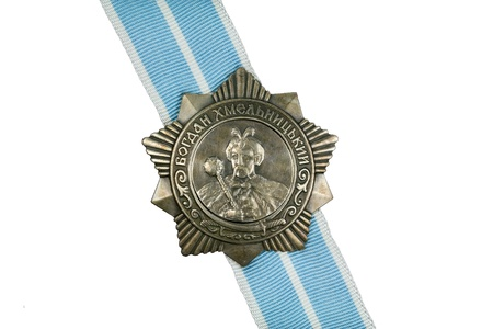 Order of Bohdan Khmelnytsky III degree on the ribbon on a white background  Stock Photo