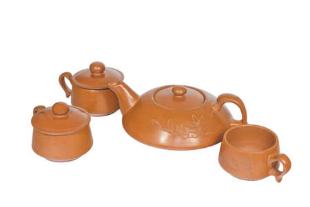 Brown ceramic tea set on a white background.