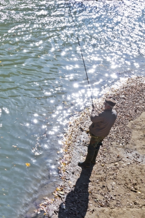 A man fishing on the bank of the river  Stock Photo - 18198959