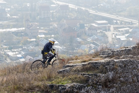 Cyclist on a mountain trail to the city background Stock Photo - 18198958