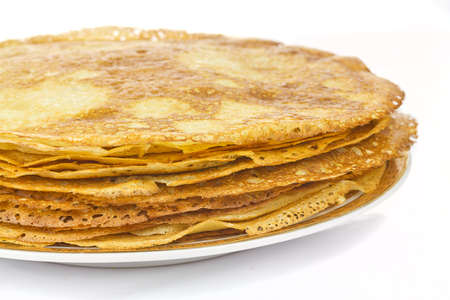 Pancakes in plate on white background