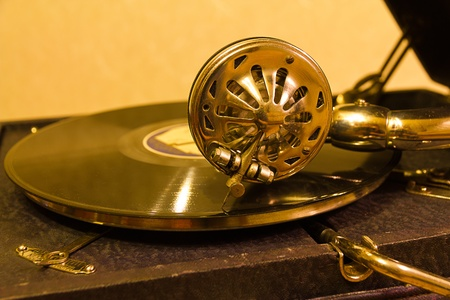 Old gramophone in gold tones  Stock Photo