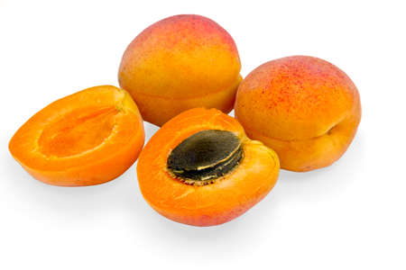 Ripe apricots on a white background.