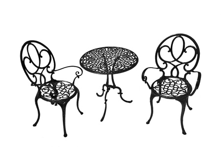 Metal chairs and a table on a white background. Stock Photo