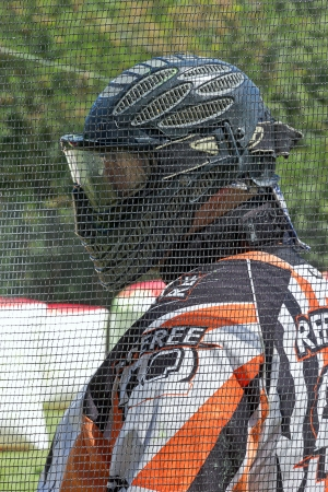 Referee on a paintball in helmet with protective mask