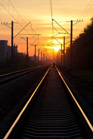 Early morning. Orange sun rise over railroad.