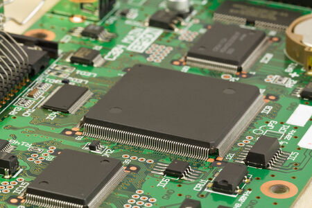 Printed circuit board with processor close-up. Stock Photo