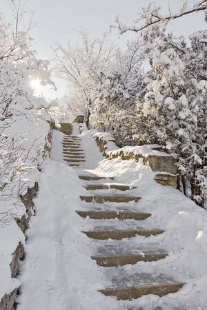 The old stone staircase covered with snow
