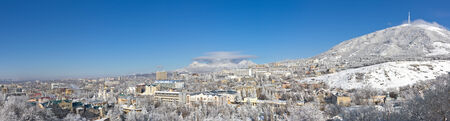 Panorama of winter mountains in the background of the city Stock Photo