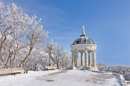 Stone gazebo Aeolian Harp on background of a winter landscape.  Stock Photo
