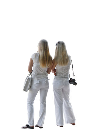 white pants: The two girls in white pants and a white blouse on a white