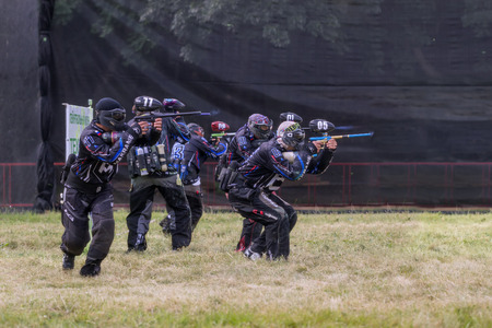Pyatigorsk, Russia - July 19, 2014: Paintball. Competitions in a forest glade. Athletes shoot in special equipment from the airguns.