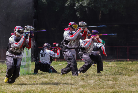 paintball: Pyatigorsk, Russia - July 19, 2014: Paintball. Competitions in a forest glade. Athletes shoot in special equipment from the airguns.
