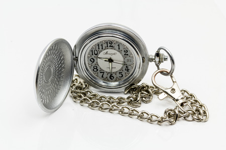 Pocket watch with chain fastened. On a white background. Stock Photo