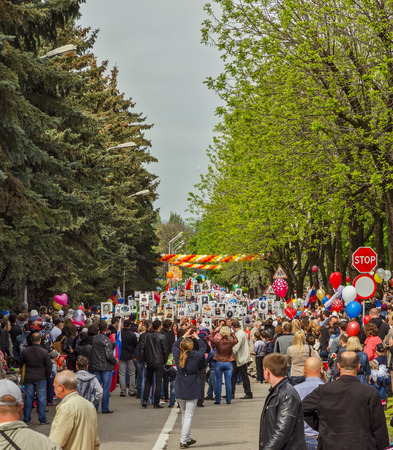 Pyatigorsk, Russia - May 9, 2014: Demonstration dedicated to to Victory Day. Pyatigorsk. People with placards are on the streets.