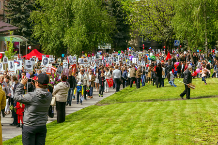 Pyatigorsk, Russia - May 9, 2014: Festive demonstration dedicated to the to Victory Day. Pyatigorsk. People with portraits of relatives who had fought are on the streets.