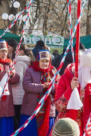 maslenitsa: Pyatigorsk, Russia. March 22, 2015 : Maslenitsa. Older woman in a bright shawl on a city holiday. Pyatigorsk, maslenitsa. Editorial