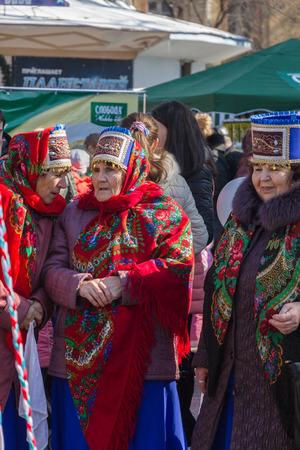 pyatigorsk: Pyatigorsk, Russia. March 22, 2015 : Maslenitsa. Elderly women in bright folk costumes at the city celebration. Pyatigorsk, maslenitsa.