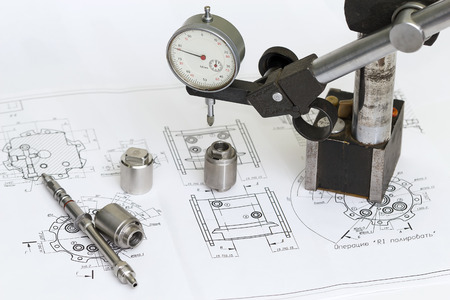 micrometer: Micrometer and machine parts in the drawing.