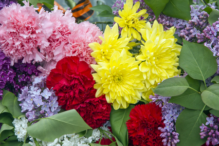 Red and pink carnation, lilac and bright yellow flowers.