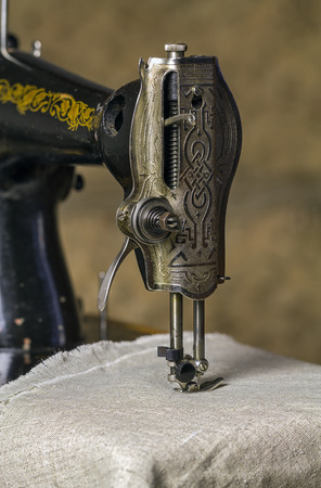 sewing cotton: Detail of an old sewing machine.