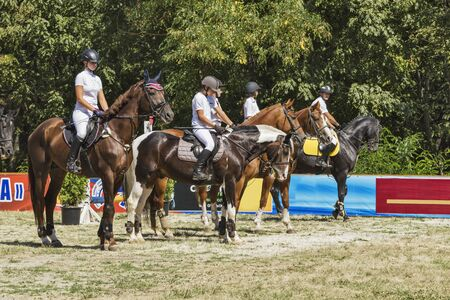 Pyatigorsk. Russia - September 05.09.2015 : Pyatigorsk. Forest Glade.Young men and girls in clothes of riders on horseback. Stock Photo