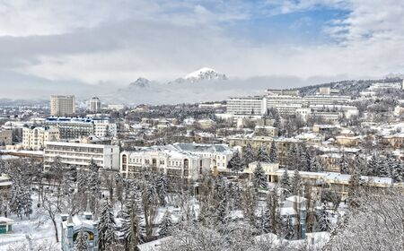 Panorama of Pyatigorsk city covered with snow. Against the backdrop of the mountains. Stock Photo