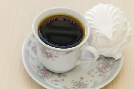 Cup of black coffee and cake in a saucer. Stock Photo