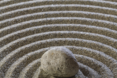 Stones and ring lines in the sand. Stock Photo