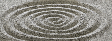 Drawing on the sand in a spiral. Stock Photo