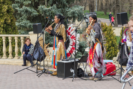 Yessentuki, Russia. April 09.2016: Performance of street musicians in Indians costumes in the town square. Editorial