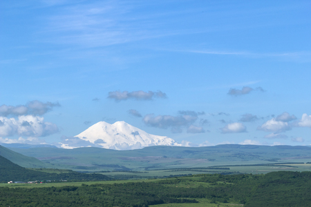 Panorama from snow-covered Mount Elbrus on the horizon. Stock Photo