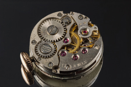 Old clock mechanism with ruby stones and gears. Stock Photo