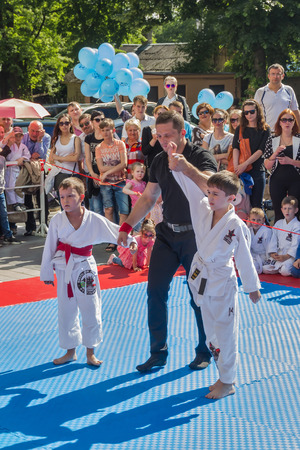 Pyatigorsk, Russia -June 12.2016: Demonstration competitions in judo at the city holiday. The referee declares the winner demonstration competitions in judo among boys 6-10 years old. Editorial