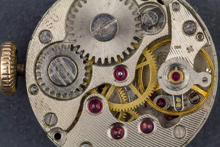 Old clock mechanism with rubies and gears. Stock Photo