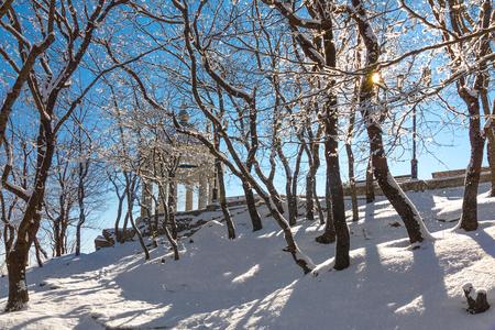 Rotunda in a winter park on a sunny frosty day.