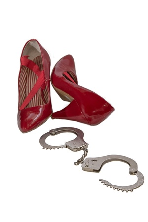 Handcuffs and red shoes