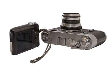 Two cameras of different generations on a white background