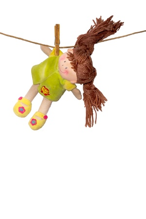 A soft doll dries on a linen rope Stock Photo