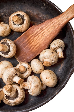 Mushrooms and fresh vegetables on the rusty pan