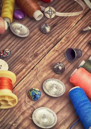 button and threads for sewing and embroidery Stock Photo