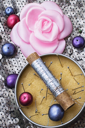 skillfully: reel of thread on the background of different jewelry Stock Photo