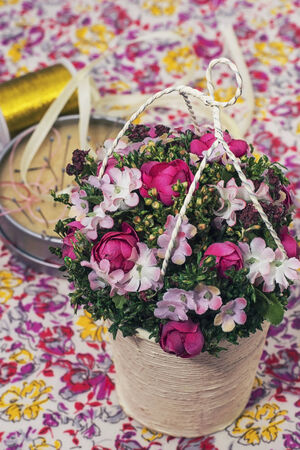 basket embroidery: handmade bouquet of flowers in a basket