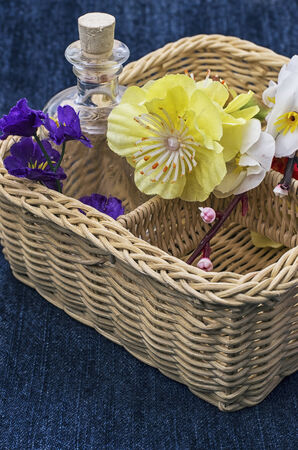 basket embroidery: wicker basket with different flowers Stock Photo