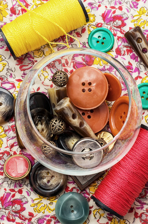 suture: buttons and zipper on the background of sewing tool Stock Photo
