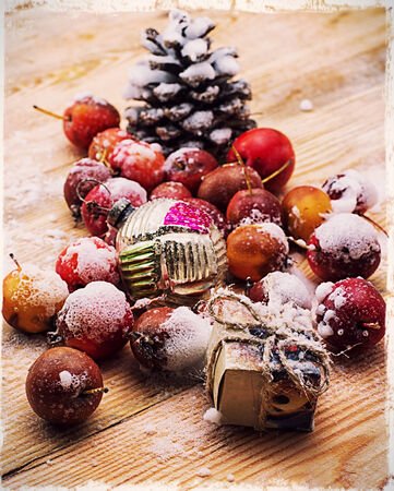 dwarf christmas: snow-covered fruits of dwarf apples and Christmas decorations