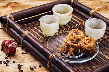 vintages: tea set and Oriental sweets in retro style Stock Photo