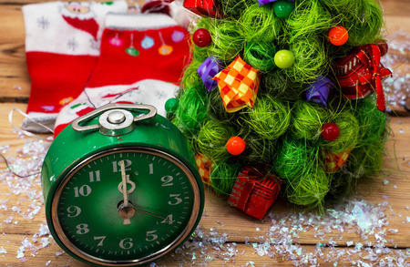 oldfashioned: postcard with green old-fashioned clock and Christmas ornaments Stock Photo