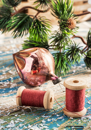 suppository: various outdated Christmas toys in a cardboard box